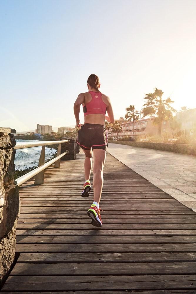 runner sunlight boardwalk location photographer