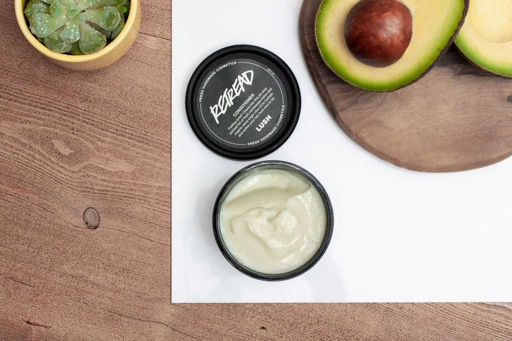 lush retread conditioner pot flatlay with avocado