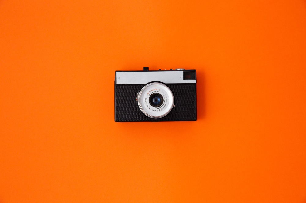 vintage 35mm camera on orange